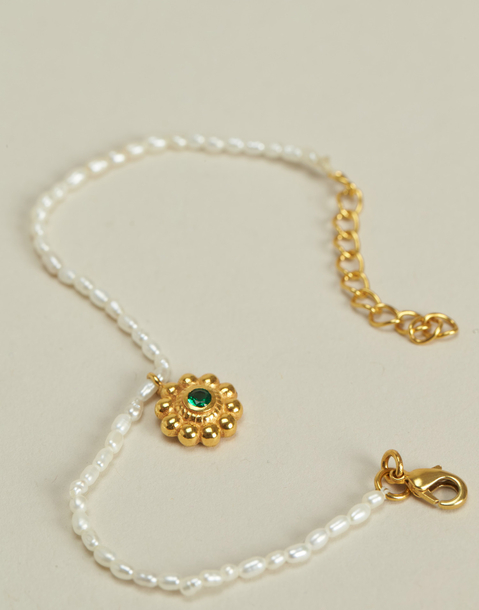 pearl bracelet with flower pendant