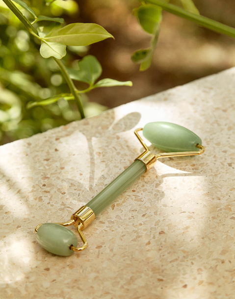 green quartz roll-on massager