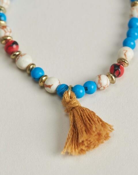 beads and pompom bracelet