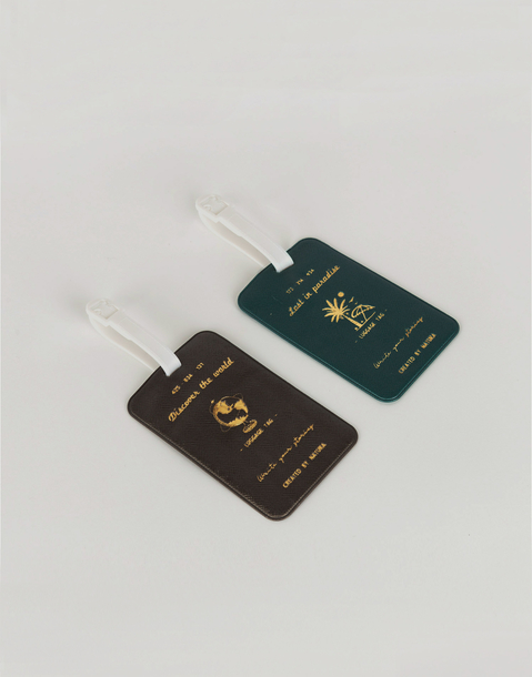 golden suitcase tag