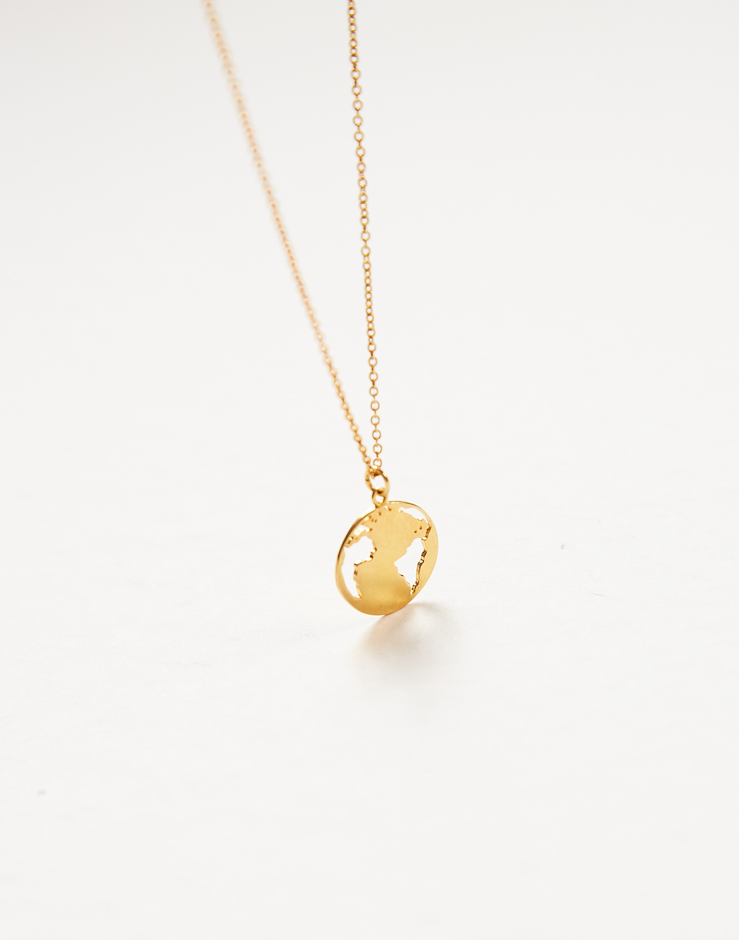 Gold plated world medal necklace