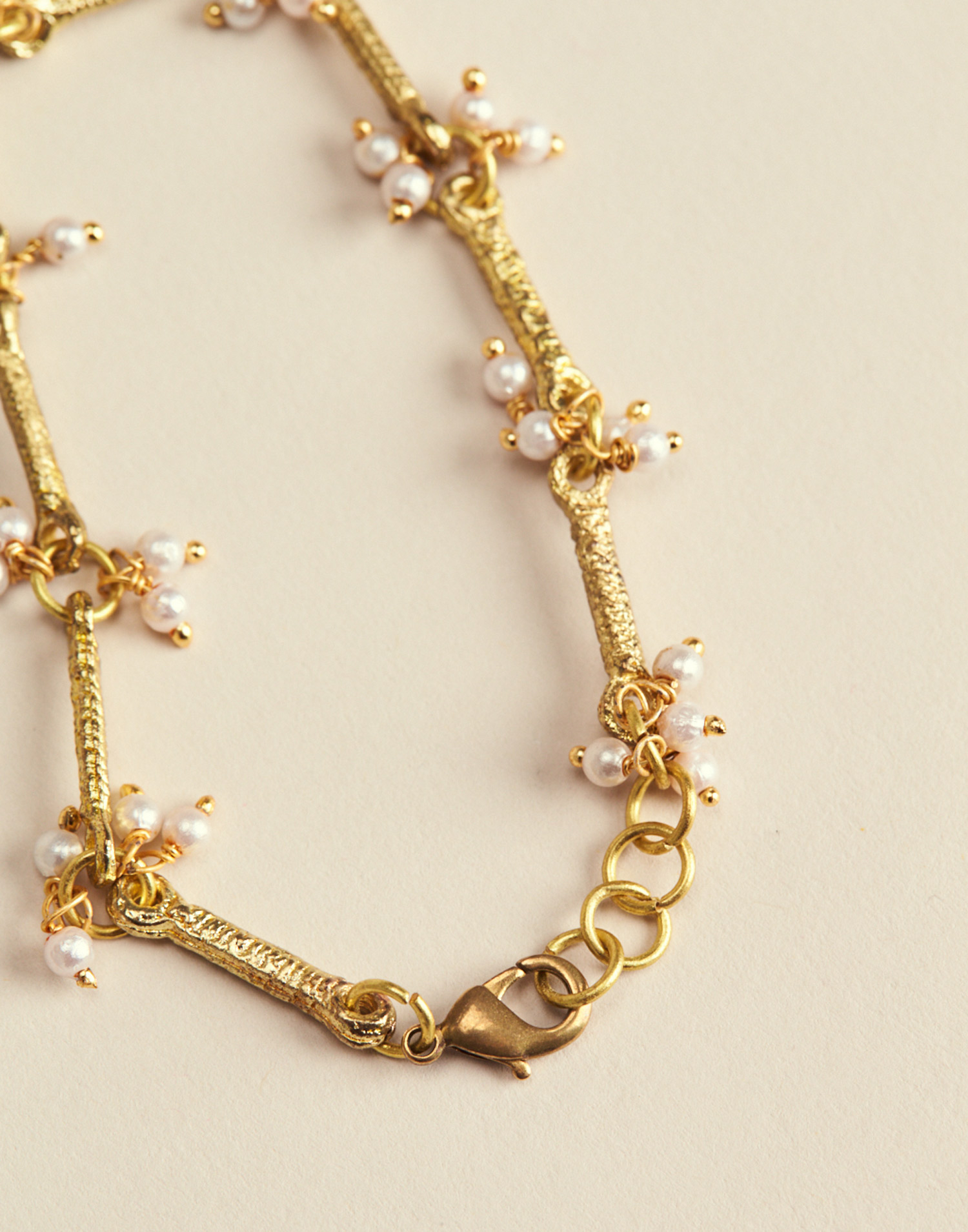 Pulsera perlas colgantes