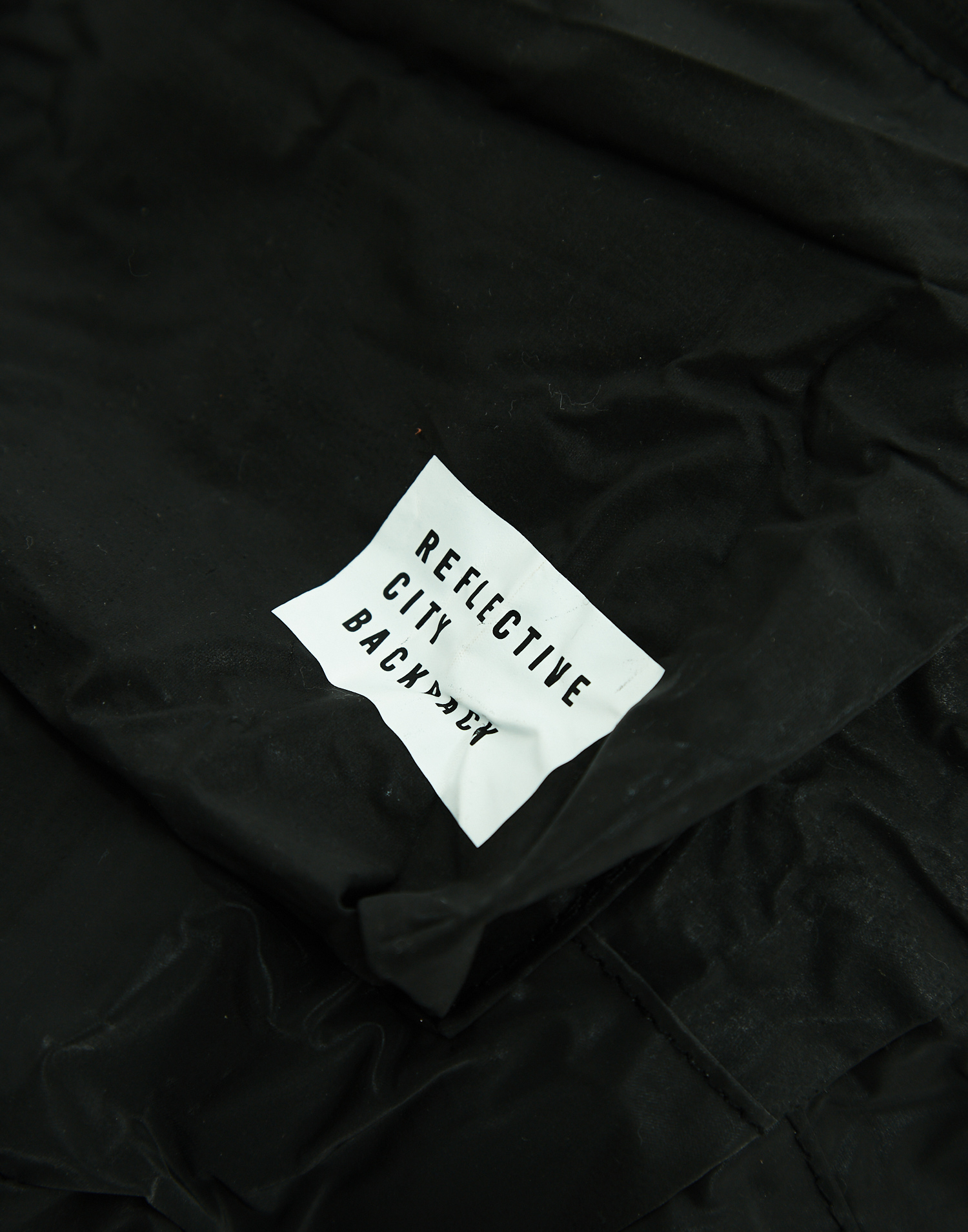 Foldable reflective backpack