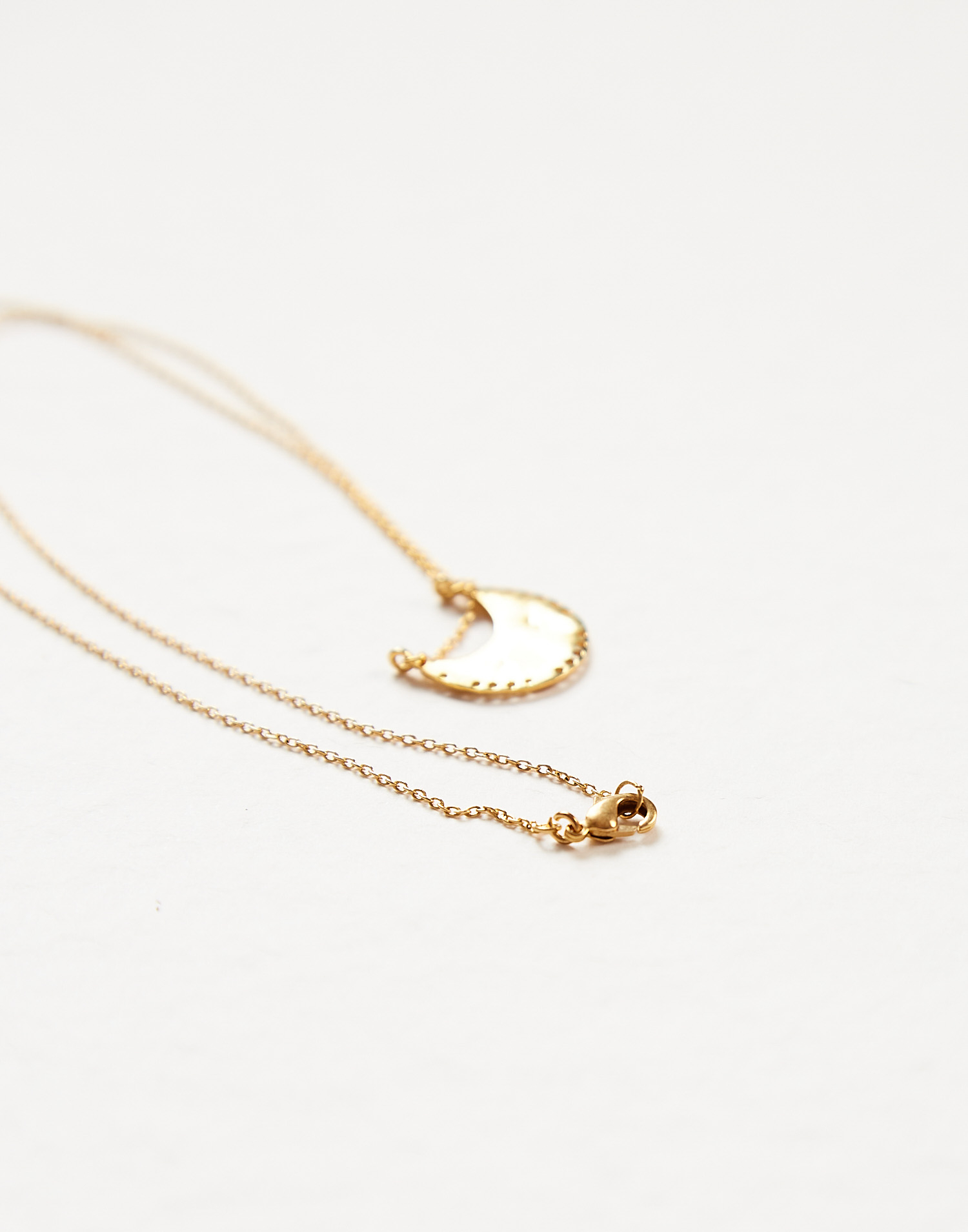 Gold plated half moon pendant necklace