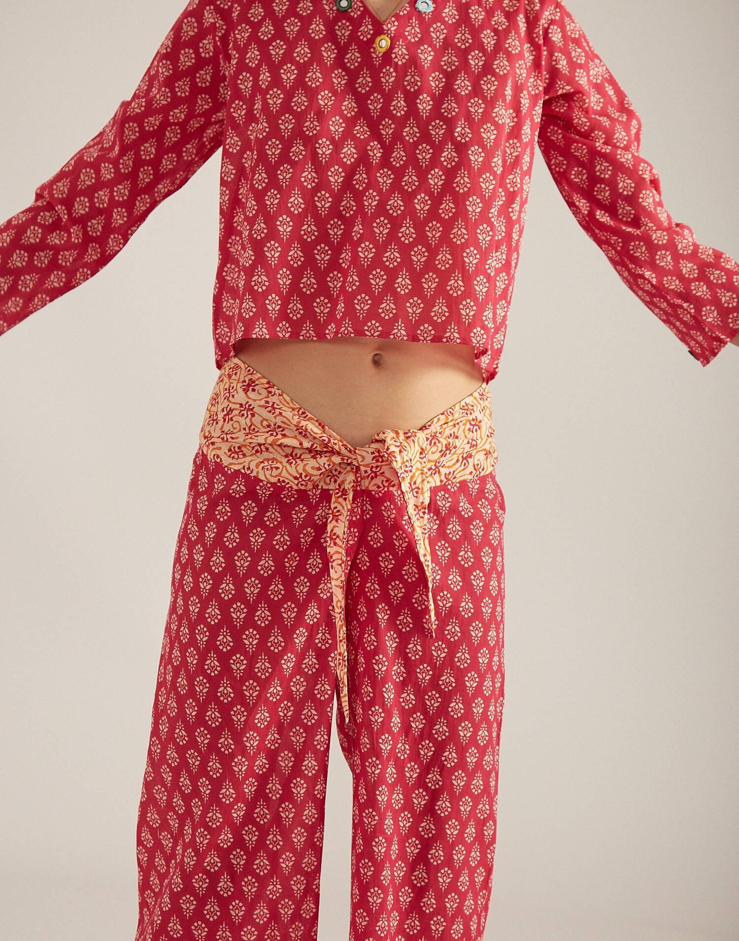Pantalón largo nudo con espejos
