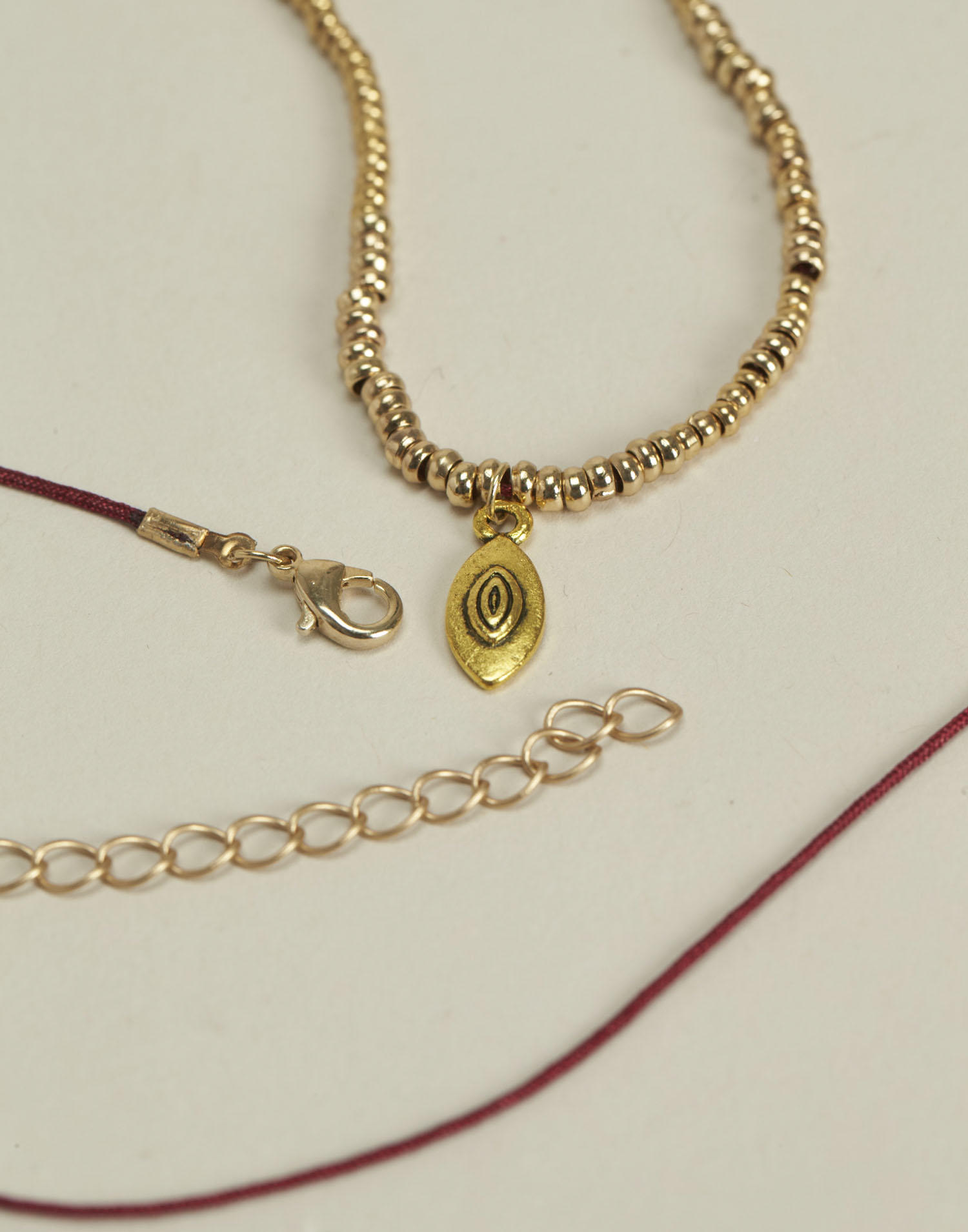 Thread and tear necklace