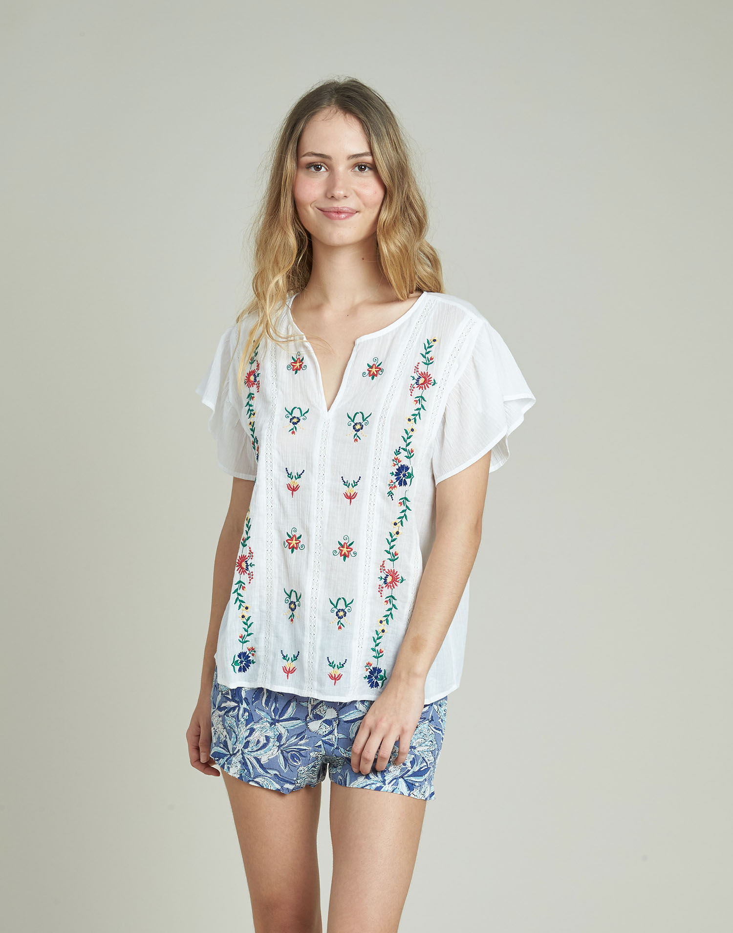 Embroidered ruffles blouse