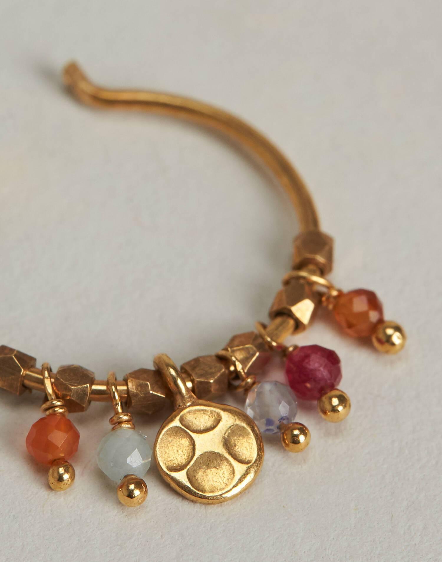 Gilded charmed hoop earring
