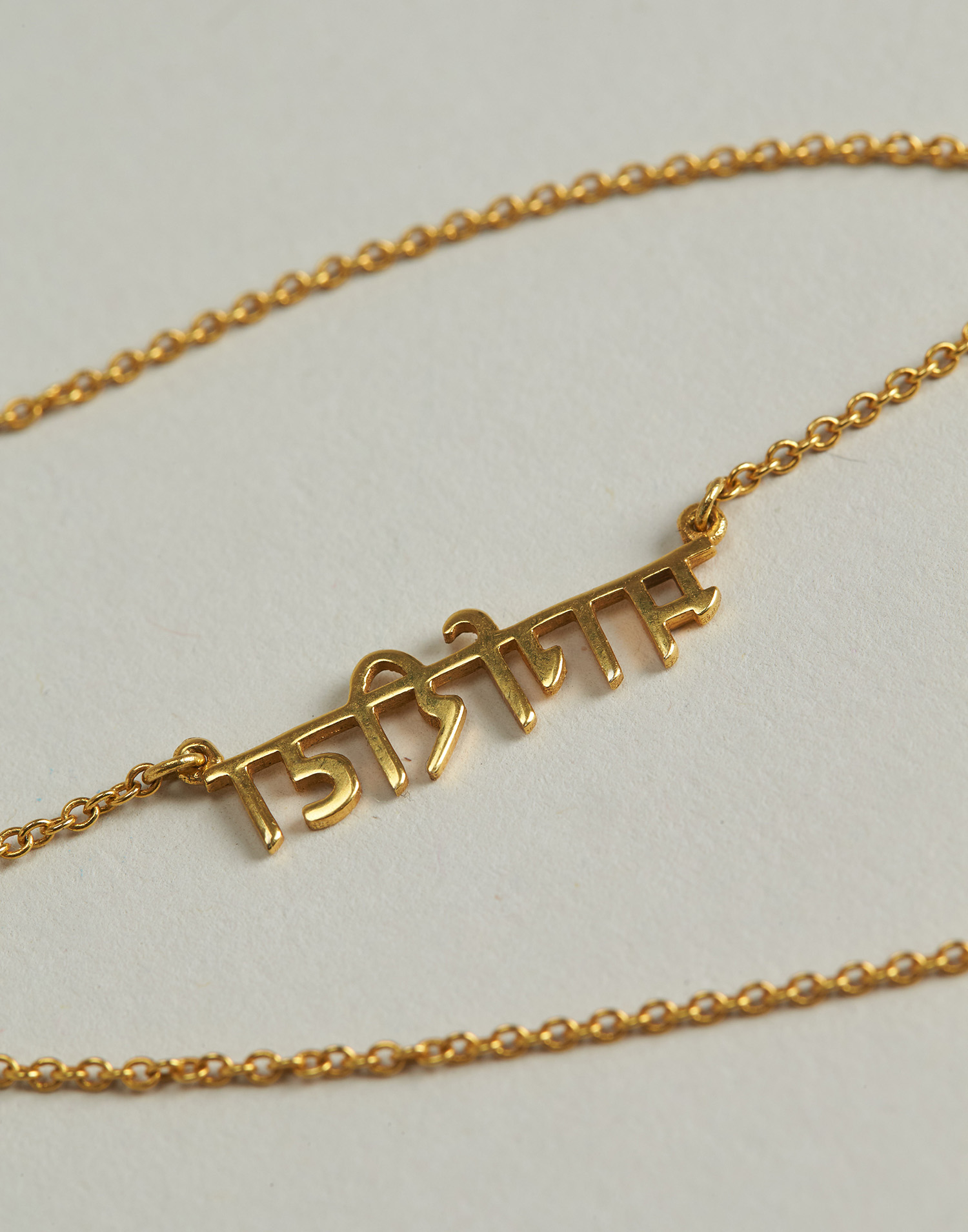 Gold plated hindi necklace