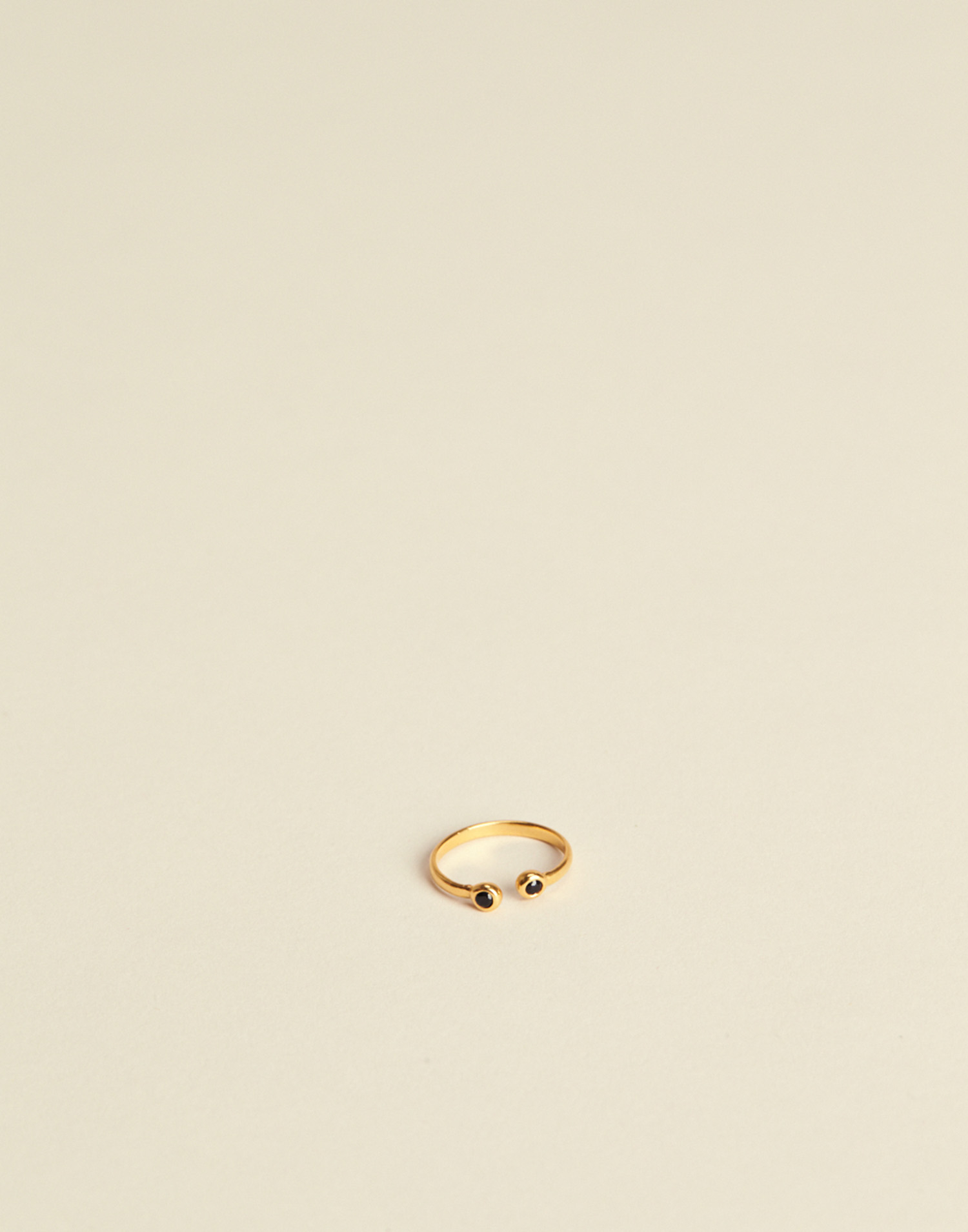 Gilded ring with stones