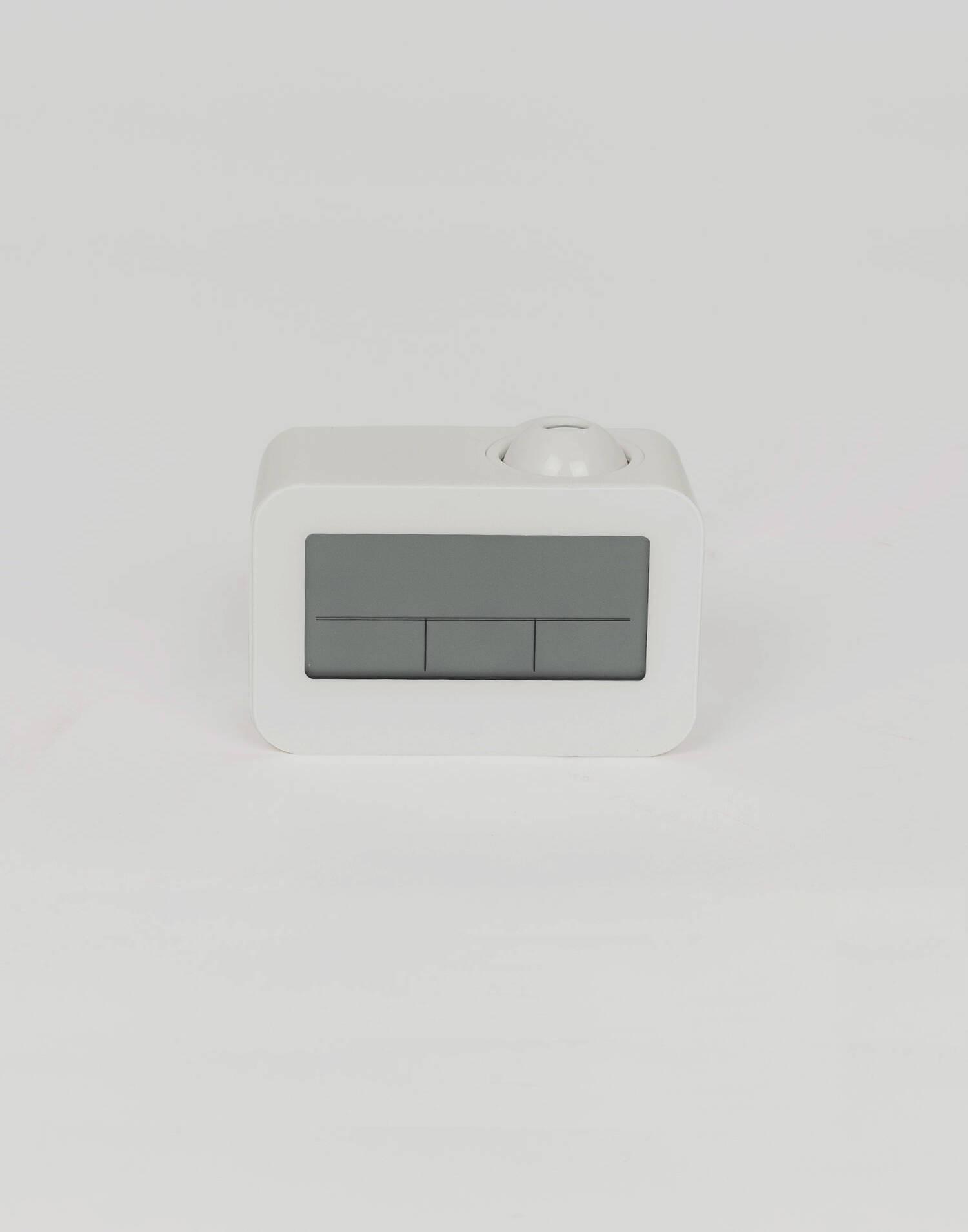 Alarm clock with projector
