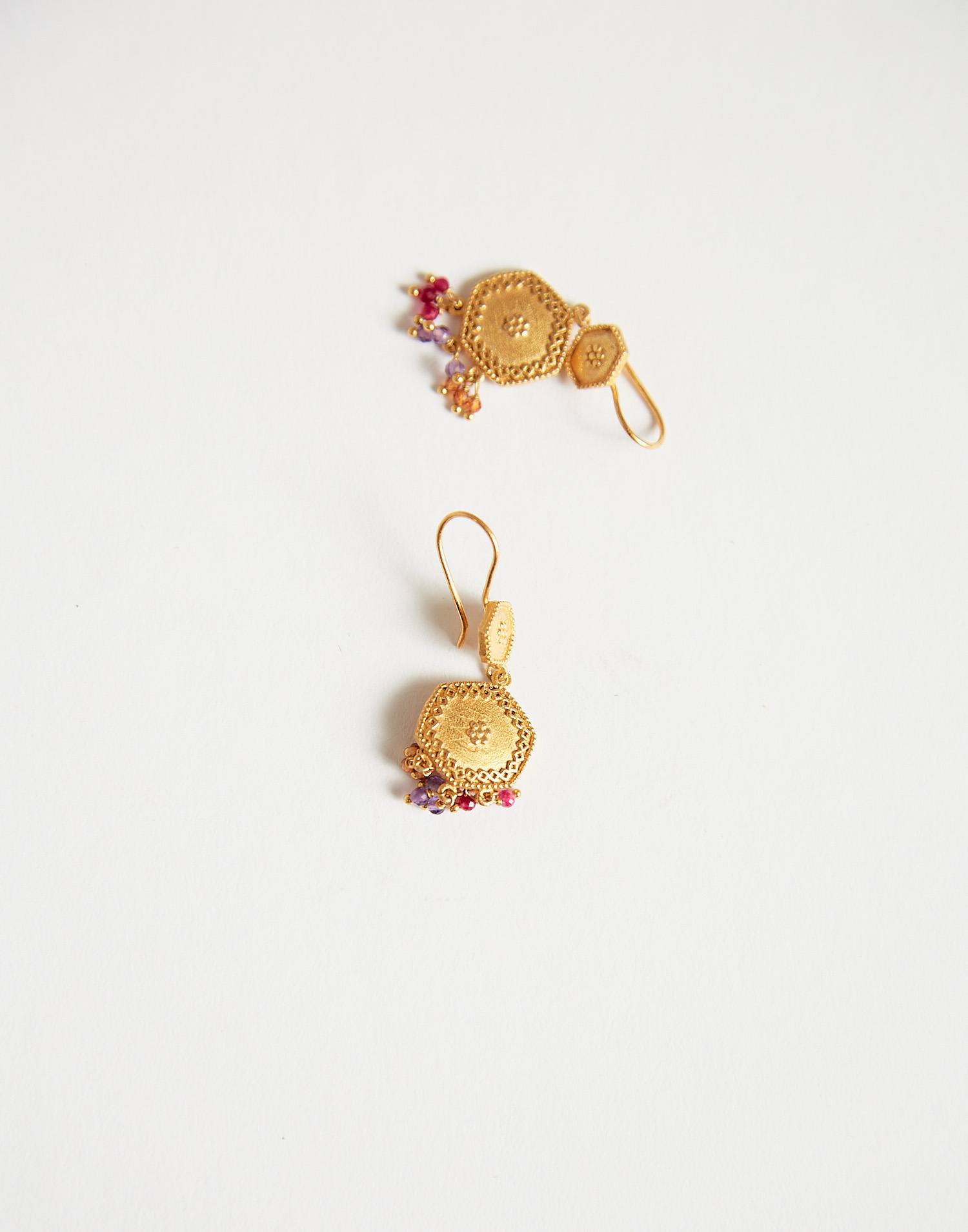 Gold plated medal and stones earring