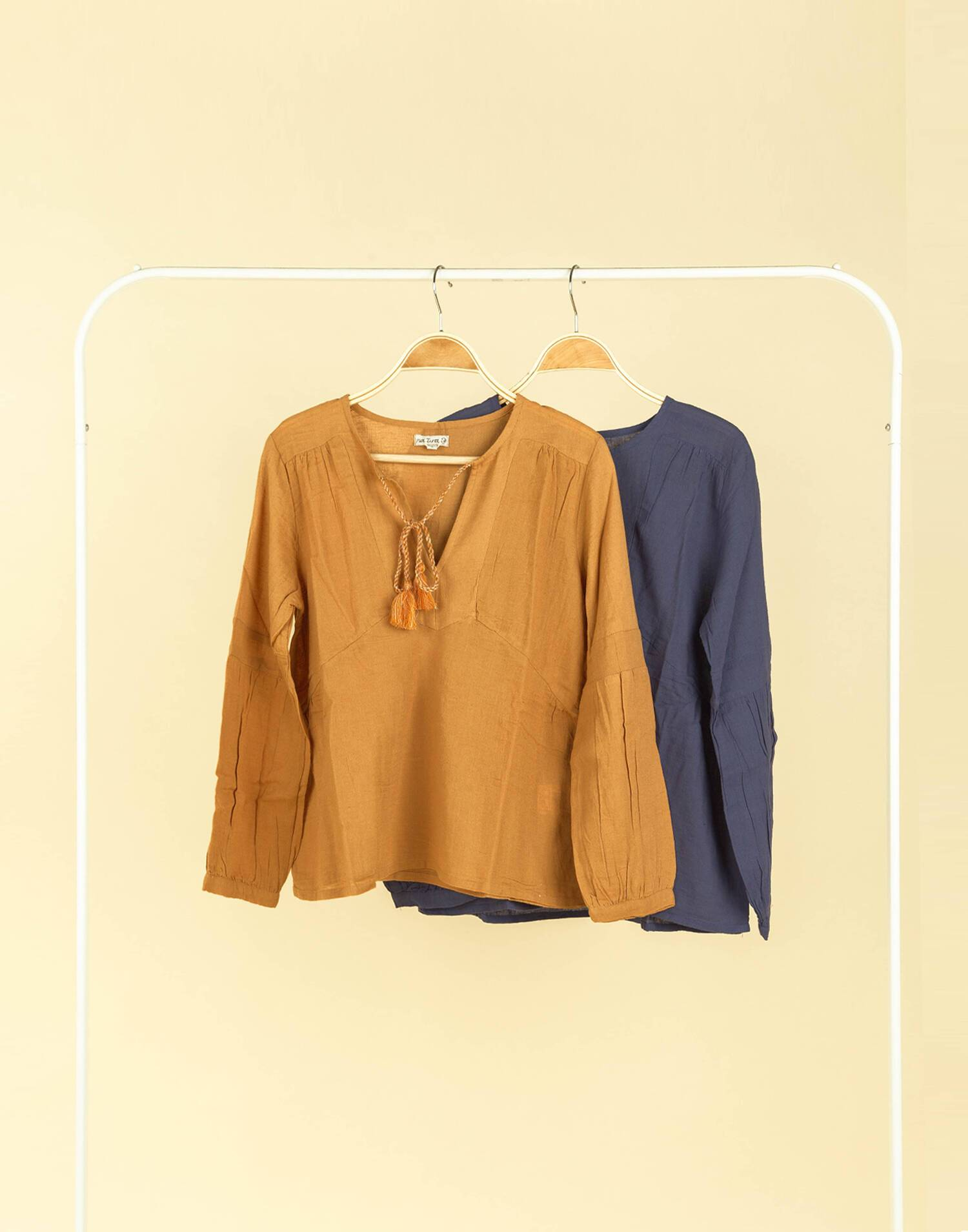 LONG SLEEVE BLOUSE WITH POMPOMS
